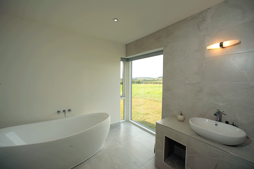 contemporary bathroom with a view by cork builder niall linehan construction