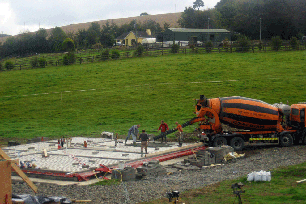 Innishannon Period New Build laying insulation on top of the Raft-Foundations